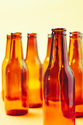 empty and brown glass bottles - p1166m2073574 by Cavan Images