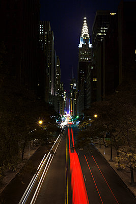Chrysler building illuminated at night from the East Side - p1280m1122735 by Dave Wall