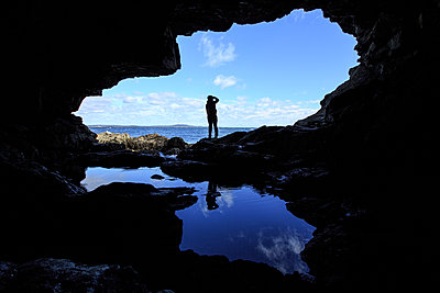 Silhouette of person from Anemone Cave in Acadia National Park - p343m1217992 by Matt Andrew