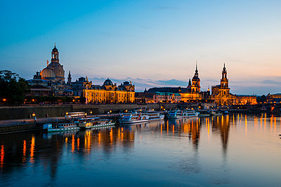 Germany, Saxony, Dresden, View of Academy of Fine Arts, Bruehl's Terrace, Sekundogenitur, Hausmann Tower, House of the Estates,  Dresden Cathedral, Semper Opera House and Augustus Brigde with Elbe waterfront in the evening - p300m965334f by Walter G. Allgöwer