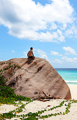 Man on the rocks - p0452401 by Jasmin Sander