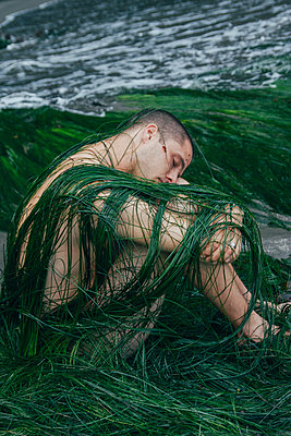 Man Draped in Ocean Plants - p1262m1125267 by Maryanne Gobble