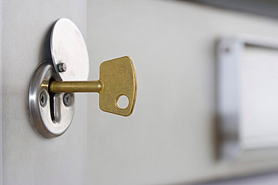 A key in a lock - p9248251f by Image Source