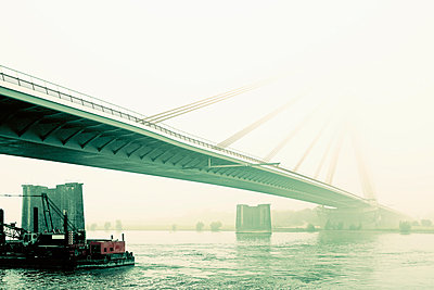 Germany, Wesel, cable stayed bridge in the mist - p300m1023092f by Mel Stuart
