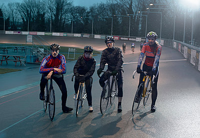 Portrait of young adult cyclists at velodrome - p429m928897f by Dark Horse