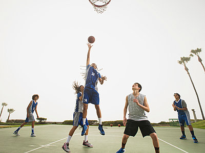 Basketball teams playing on court - p555m1415515 by Erik Isakson