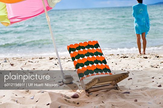 Sun chair and a sun shade on the beach Oland Sweden.