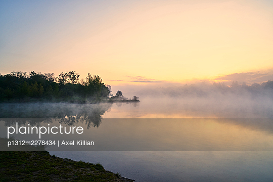 Germany, Lake in the fog with clouds - p1312m2278434 by Axel Killian