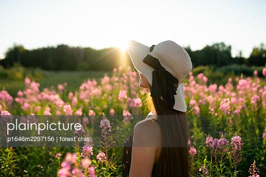 Woman on a flower meadow - p1646m2297156 by Slava Chistyakov