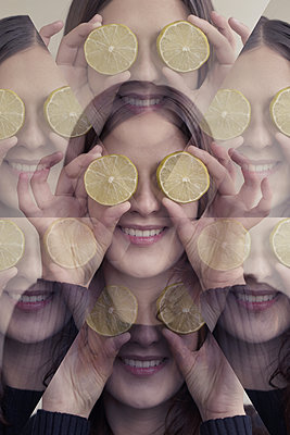 Kaleidoscope Effect of Woman with Lemons over Eyes - p1617m2264071 by Barb McKinney