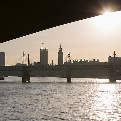 Hungerford Bridge, under Waterloo Bridge with Houses of Parliament in background, London, England, UK - p429m1084591 by Alex Holland