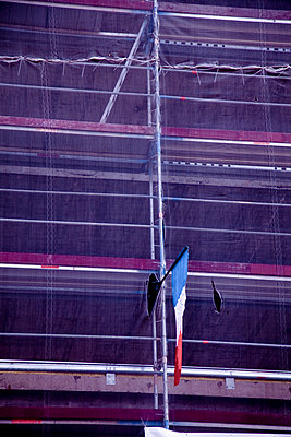 French national flag on scaffolding - p580m1161384 by Eva Z. Genthe