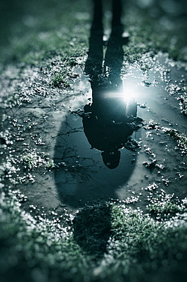 Reflection of a boy in the puddle  - p794m902118 by Mohamad Itani
