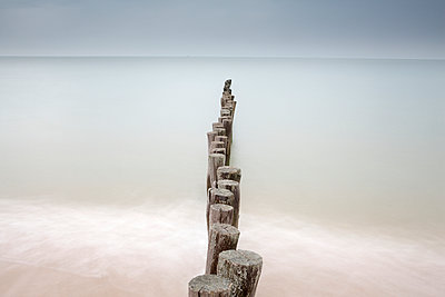 France, Brittany, Breakwater at beach of Calais - p300m998907f by David Santiago Garcia