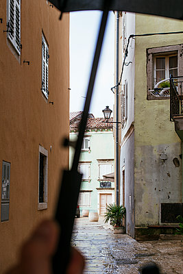 Alley in Vrsar in the rain - p728m2027251 by Peter Nitsch