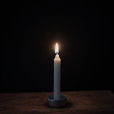 Solitary candle - p1470m1540274 by julie davenport