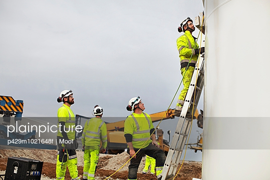 Engineers working on wind turbine - p429m1021648f by Moof