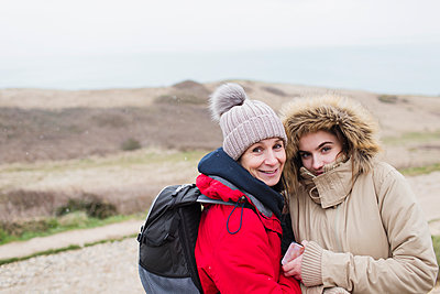 Portrait smiling mother and daughter in warm clothing - p1023m2024299 by Sam Edwards