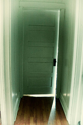 door way with light shining through cracks - p1072m857350f by Michelle Kelly