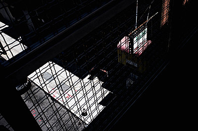 24 hour shop sign under dark elevated walkway - p301m960783f by Michael Mann