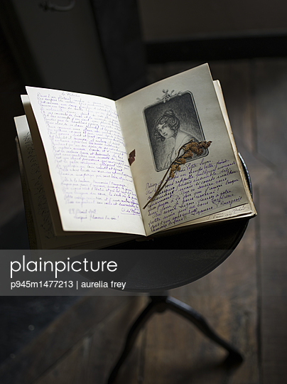 Old diary on a stool - p945m1477213 by aurelia frey