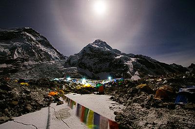 Asia, Nepal, Himalayas, Sagarmatha National Park, Solu Khumbu Everest Region, Everest Base Camp lit by moonlight - p652m716824 by Christian Kober