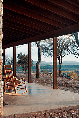Patio Porch with Rocking Chair Overlooking Rugged Hillside - p1617m2237809 by Barb McKinney