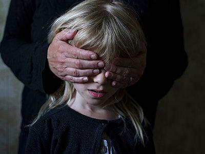 Covering eyes of blonde girl  - p945m1161608 by aurelia frey