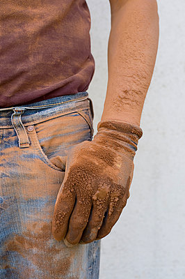 Close-up of man with dirty working glove - p300m1019127f by Claudia Rehm