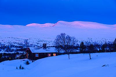 Mountain cabin in winter landscape - p312m1472353 by Mikael Svensson