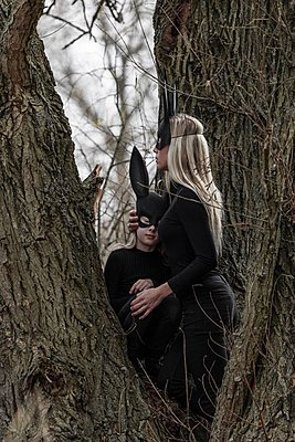 Woman and child in the woods wearing a rabbit mask.  - p896m1490491 by Rutger van der Bent