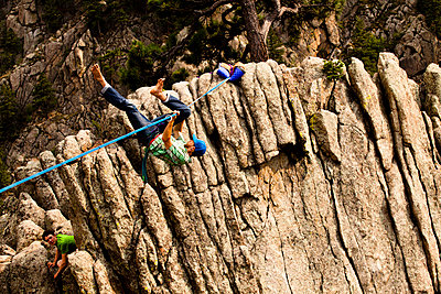 A male highliner falls off the Elephant Buttresses highline in Boulder Canyon, Colorado. - p1424m1501484 by Kyle Sparks