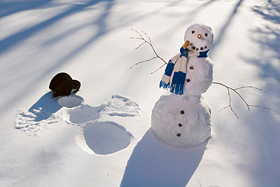 Snowman In Forest Making Snow Angel Imprint In Snow In Late Afternoon Sunlight Alaska Winter - p442m838228 by Kevin Smith