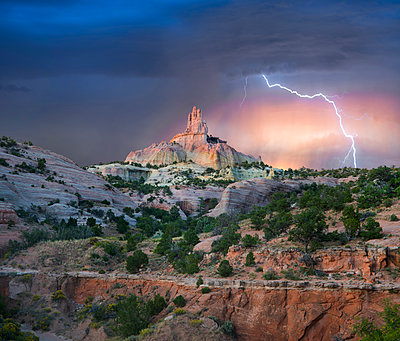 Lightning strikes near rock formation, Church Rock, Red Rock State Park, New Mexico - p884m1356984 by Tim Fitzharris