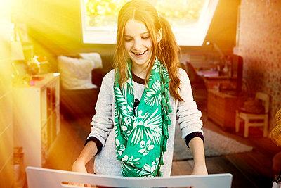 Smiling girl playing keyboard - p300m873912f by Gabi Dilly