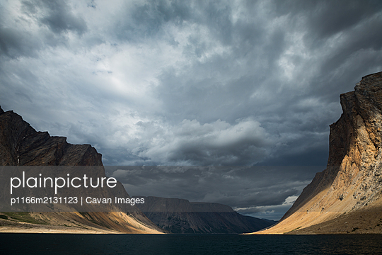Stormy skies over Torngats Mountains National Park - p1166m2131123 by Cavan Images