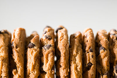 Row of cookies, close-up - p3722550 by Justin B. Paris