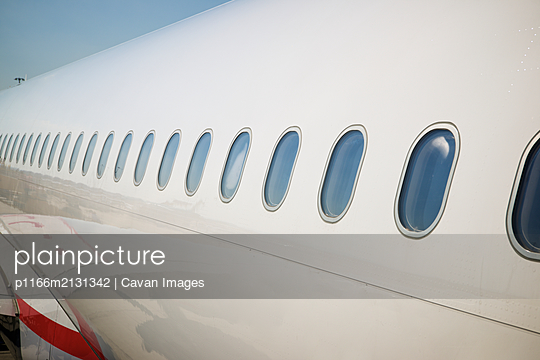 Windows of a passenger plane ready to take off. - p1166m2131342 by Cavan Images