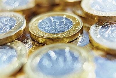 Close up one pound coins - p1023m1575886 by Adam Gault