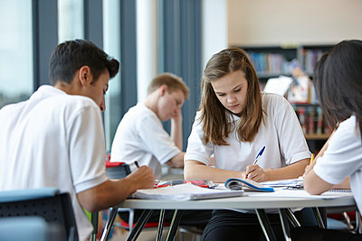Group of teenagers working in school class - p429m884626f by Phil Boorman