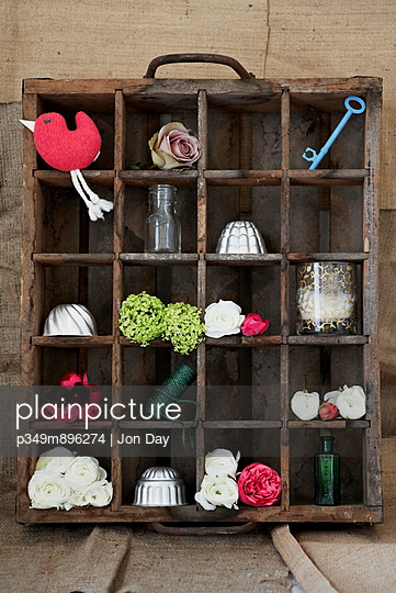 Vintage wooden crate converted to shelving solution for ornaments and trinkets - p349m896274 by Jon Day
