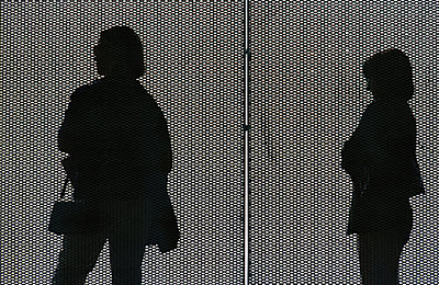 Silhouette of two women behind grid - p1418m1571646 by Jan Håkan Dahlström