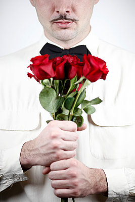 Man with roses - p611m984668 by Laurence Ladougne