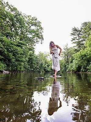 Girl in Creek - p1019m2100420 by Stephen Carroll