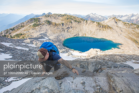A mountaineer ascends a rocky ridge on Douglas Peak, British Columbia. - p1166m2095142 by Cavan Images