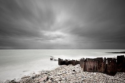 Wave-breakers along the shore - p1137m1154997 by Yann Grancher
