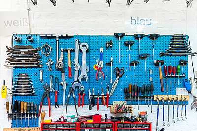 Bicycle shop, wall with various tools - p300m2197623 by Daniel Ingold