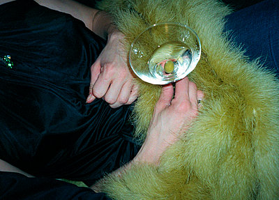 woman holding martini glass - p3880977 by Klaus Vyhnalek