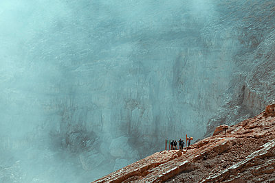 Group of tourists near Ijen lake - p1166m2137446 by Cavan Images