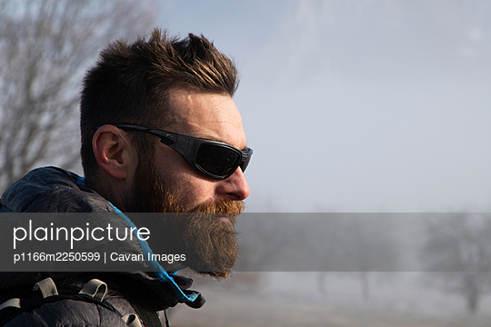 portrait of handsome man trekking in mountains in winter  outdoo - p1166m2250599 by Cavan Images